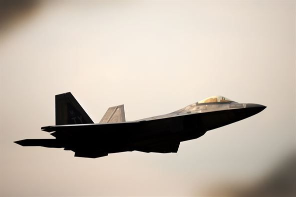 F-22 Raptors from the 95th Fighter Squadron conduct air-to-air training with…