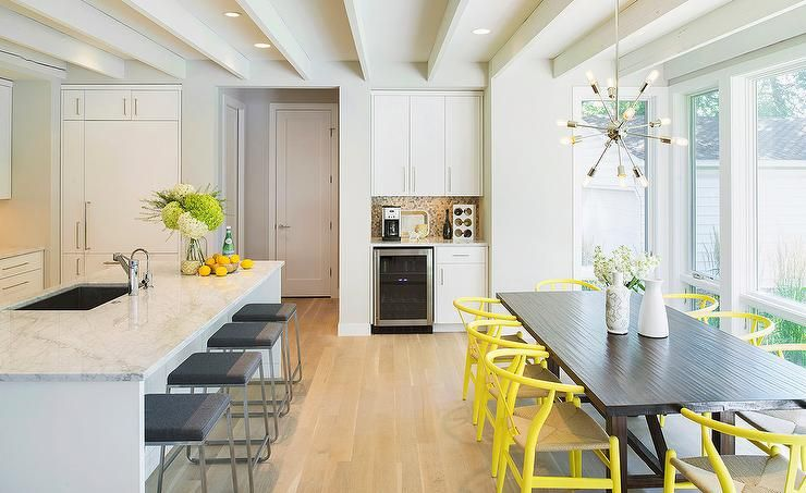 Contemporary Kitchen Features A Long Center Island Lined