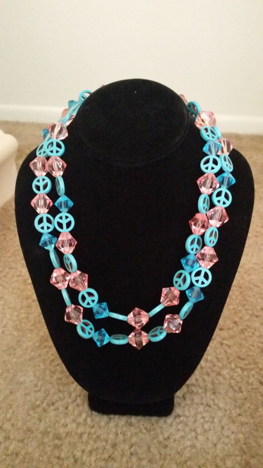 Pink and turquoise double stranded peace sign $20.00