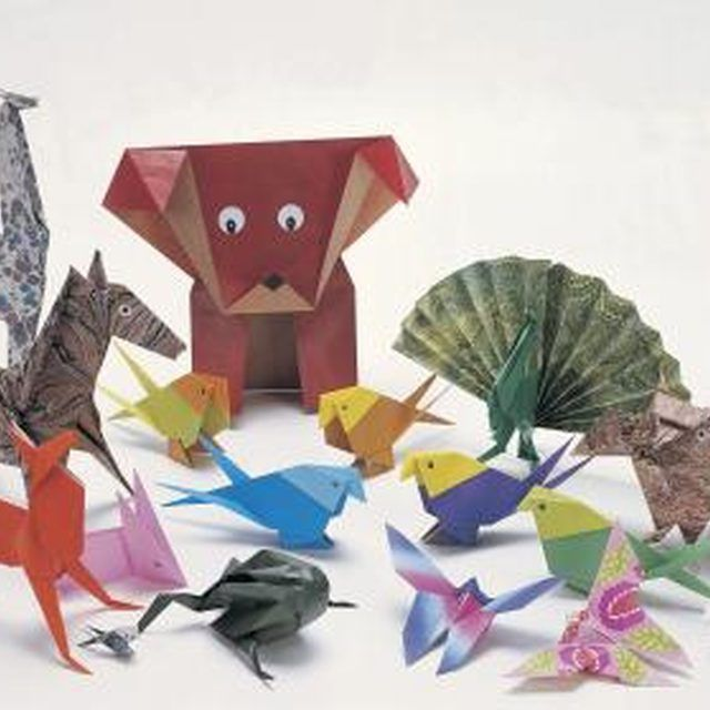 Create numerous origami designs from decorative paper media, such as a dollar bill.