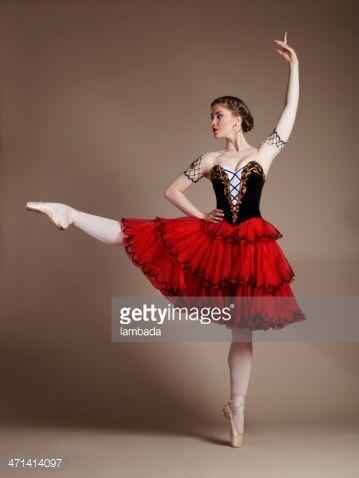 Professional ballerina dancing in studio, Role of Kitri