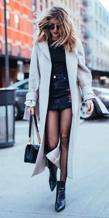 Cristina Monti + gorgeously feminine + black mini skirt + floral embroidered detailing + black top + patent black leather boots + cream maxi coat.   Skirt: Topshop....   Style Inspiration