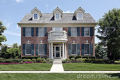 Brick Home With Blue Shutters