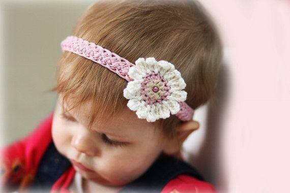 Stretchy headband with pretty flower crochet por daisychainpatterns stretchy headband with pretty flower crochet pattern mightylinksfo Choice Image