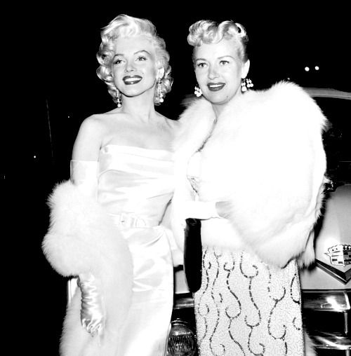 """alwaysmarilynmonroe:   Happy birthday, Betty Grable! December 18th 1916 - July 2nd 1973  Here is Marilyn and Betty together at Walter Winchell's birthday party in April 1953.  When asked by reporters in Korea in February 1954 who her best girl friends were, Marilyn said Betty Grable and Jane Russell.  Betty had been Twentieth Century Fox's top star for the past ten years and she was more than happy to hand over her title to Marilyn saying, """"Honey, I've had mine. You go get yours.""""   """"It may…"""