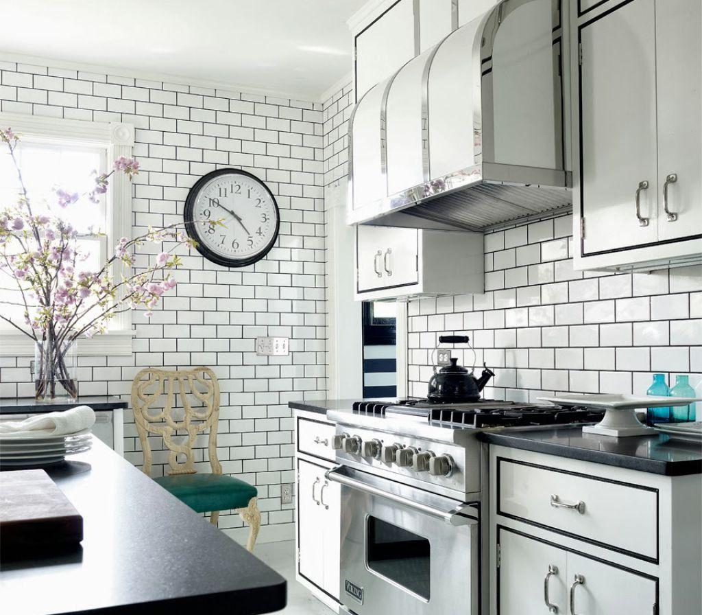 All white kitchen designed with subway tile backsplash and white