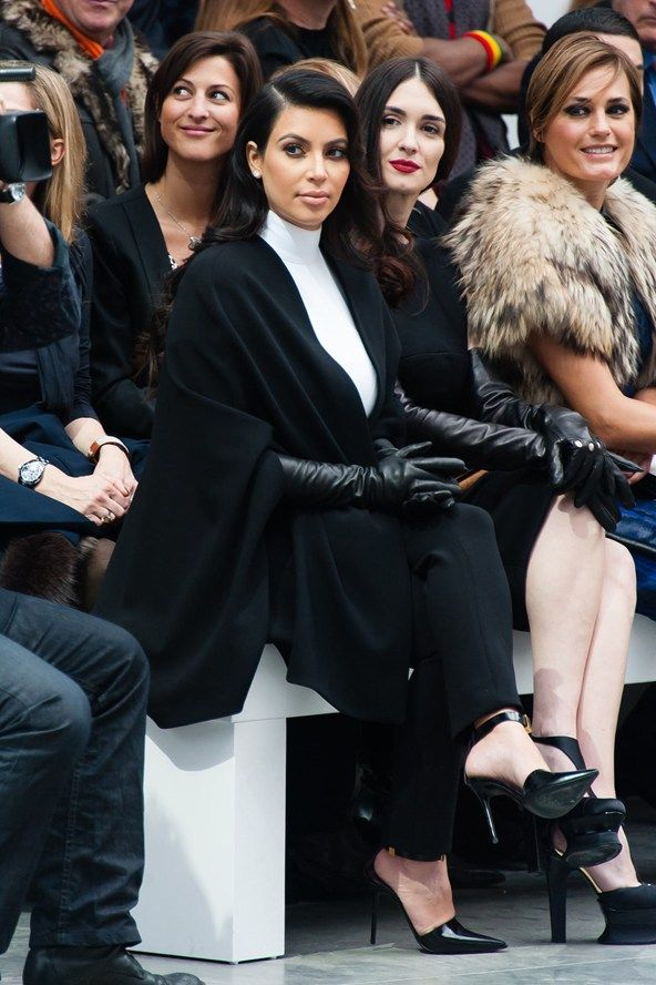 Kim Kardashian wears the Monochrome as only she can - with oodles of drama front row at Stephane Rollande.
