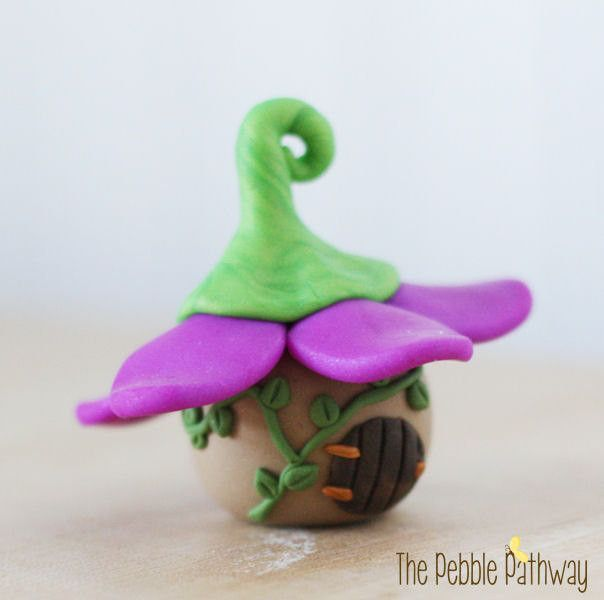 This miniature fairy house with a purple flower petal roof is for the tiniest fairies! It will add a special place for fairies to hide in the smallest of plants and gardens. This tiny fairy house or g