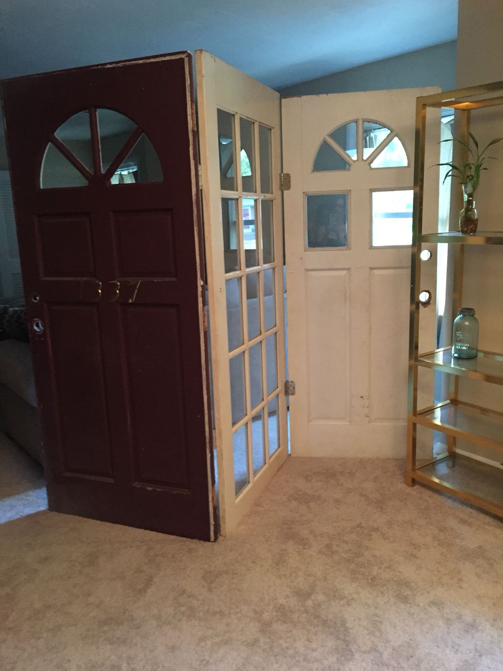 Room divider from old doors. Only cost the price of hinges (around $11.00)!