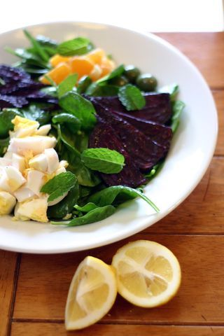 caramelized beet and tangerine salad with hardboiled eggs, olives and almonds