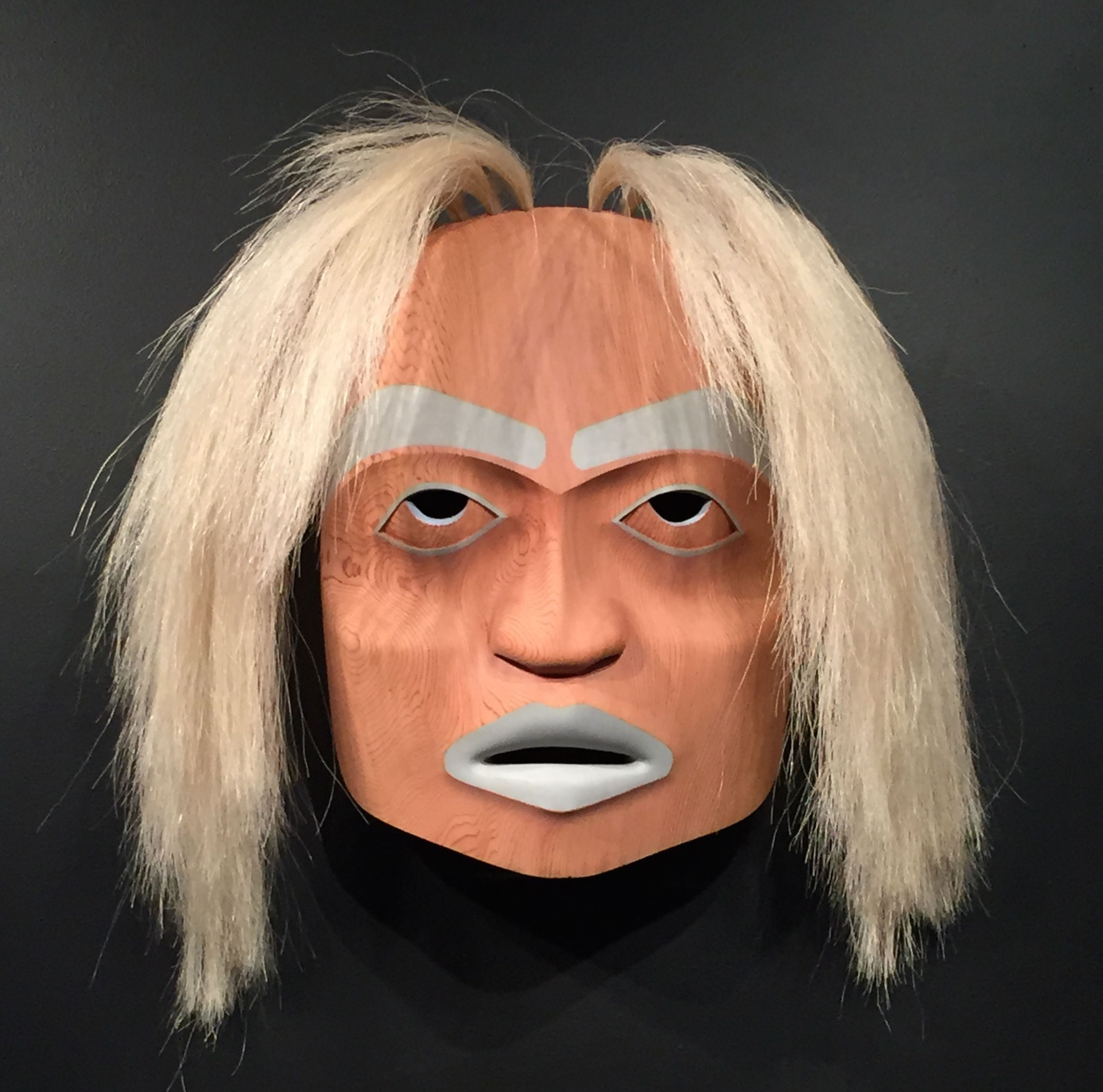 "Westcoast native portrait mask - ""Spirit Helper"" by Jody Broomfield (Squamish/Coast Salish). Red cedar, acrylic paint, horse hair."