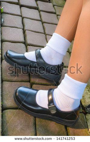 7d8fc8ed3465 Asian Thai girls schoolgirl student wear a black leather shoes as a school  uniform.