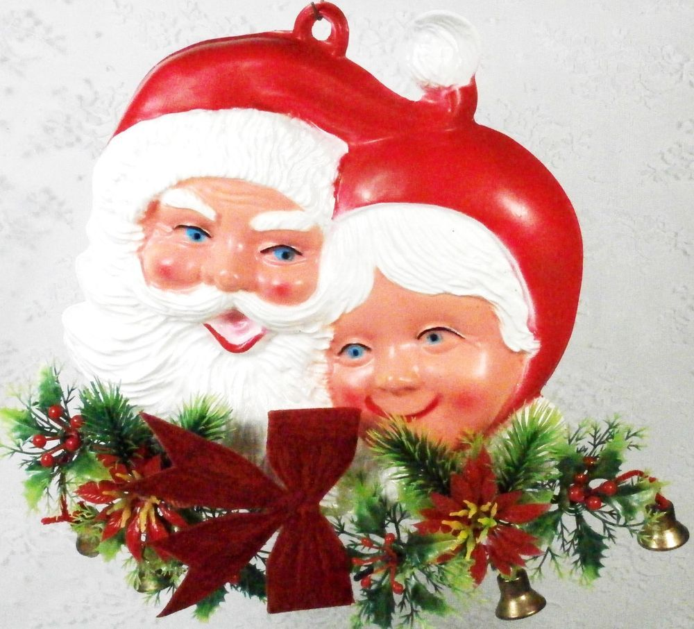 Vintage Celluloid Santa and Mrs. Claus Wall hanger