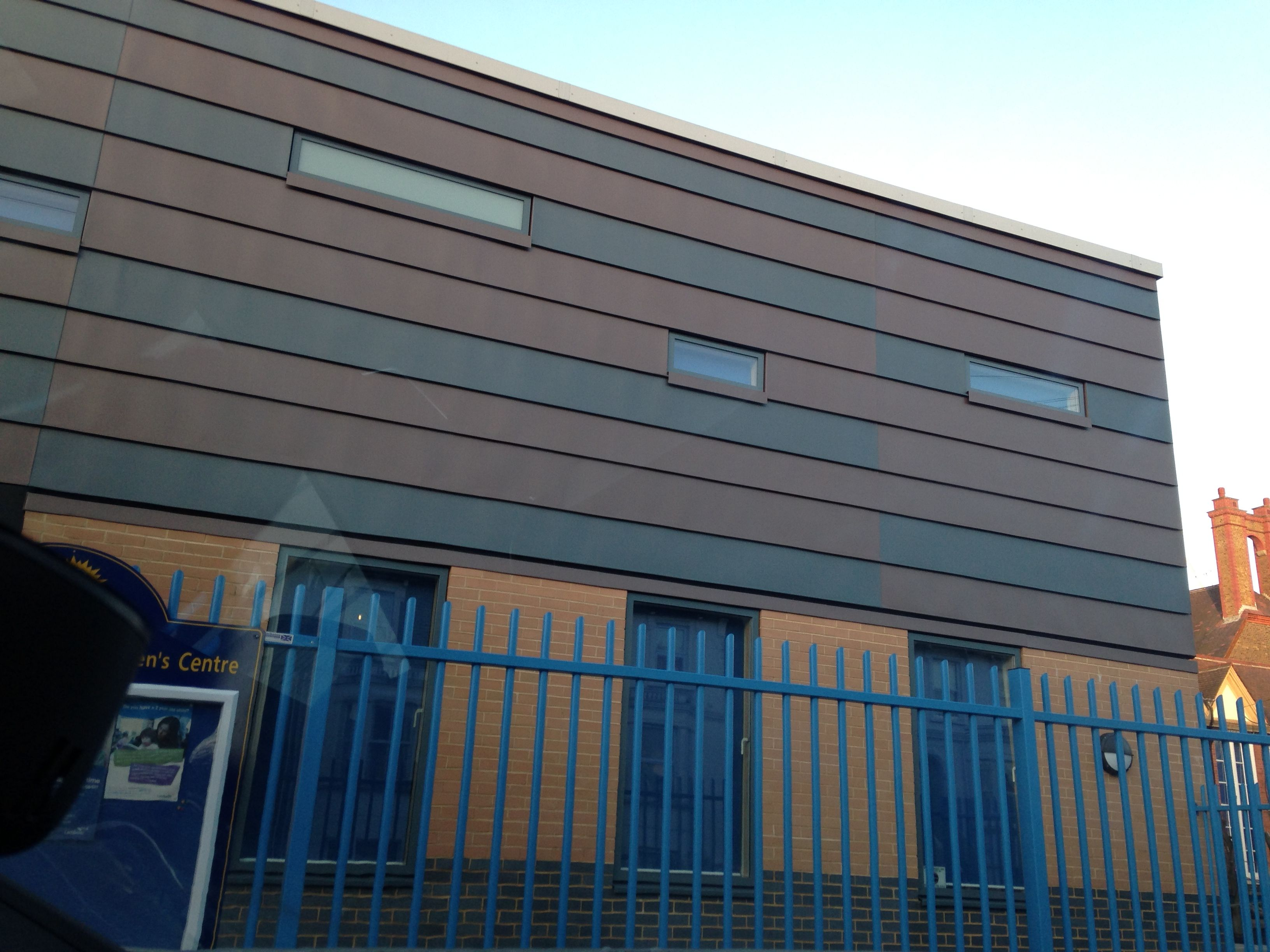 Sunnyhill Primary - VMzinc pigmento zinc cladding in red and blue