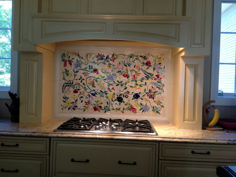 custom handcut glass tile mosaic in a floral pattern installed in our ny