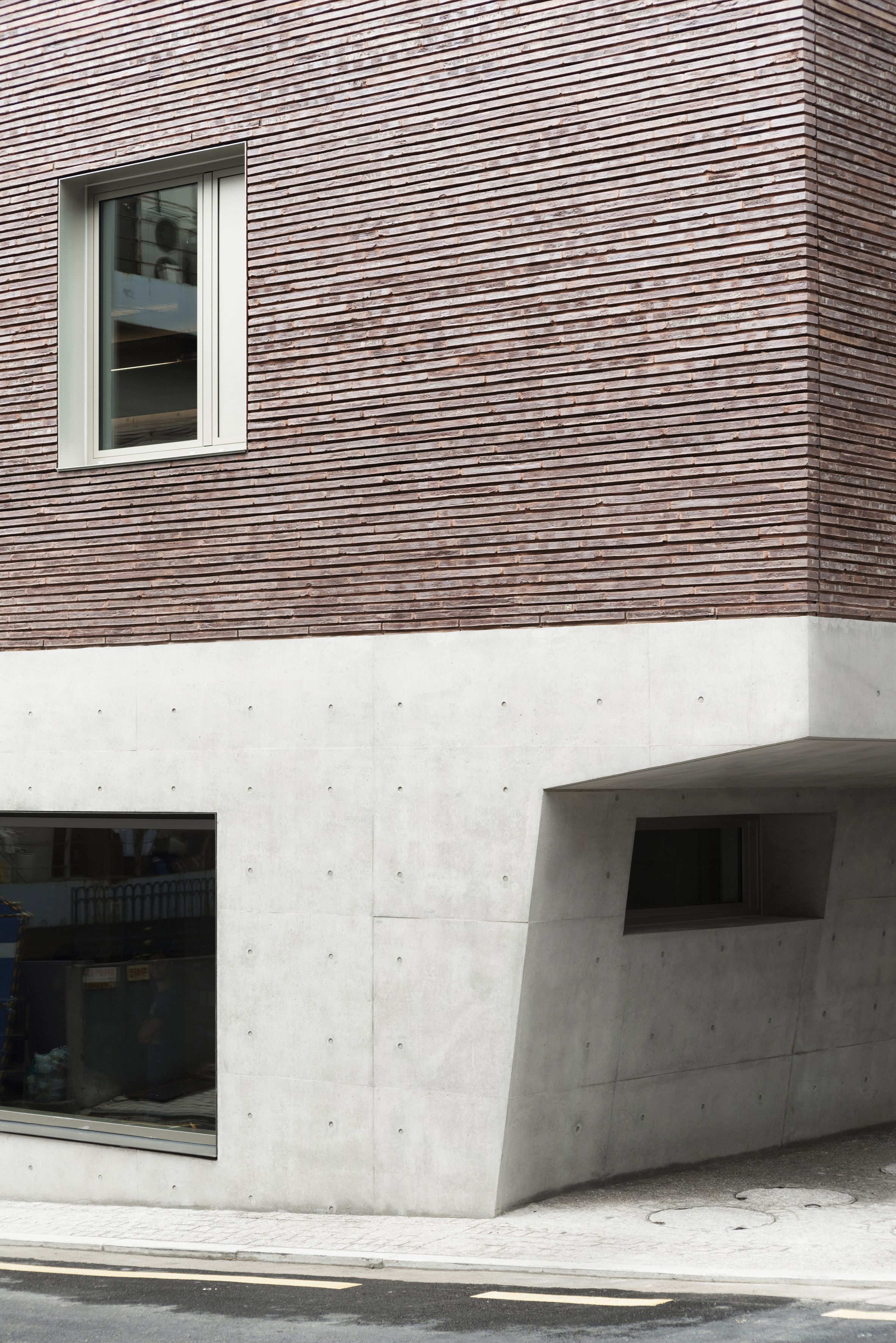 top-heavy office and apartment block features brick top and