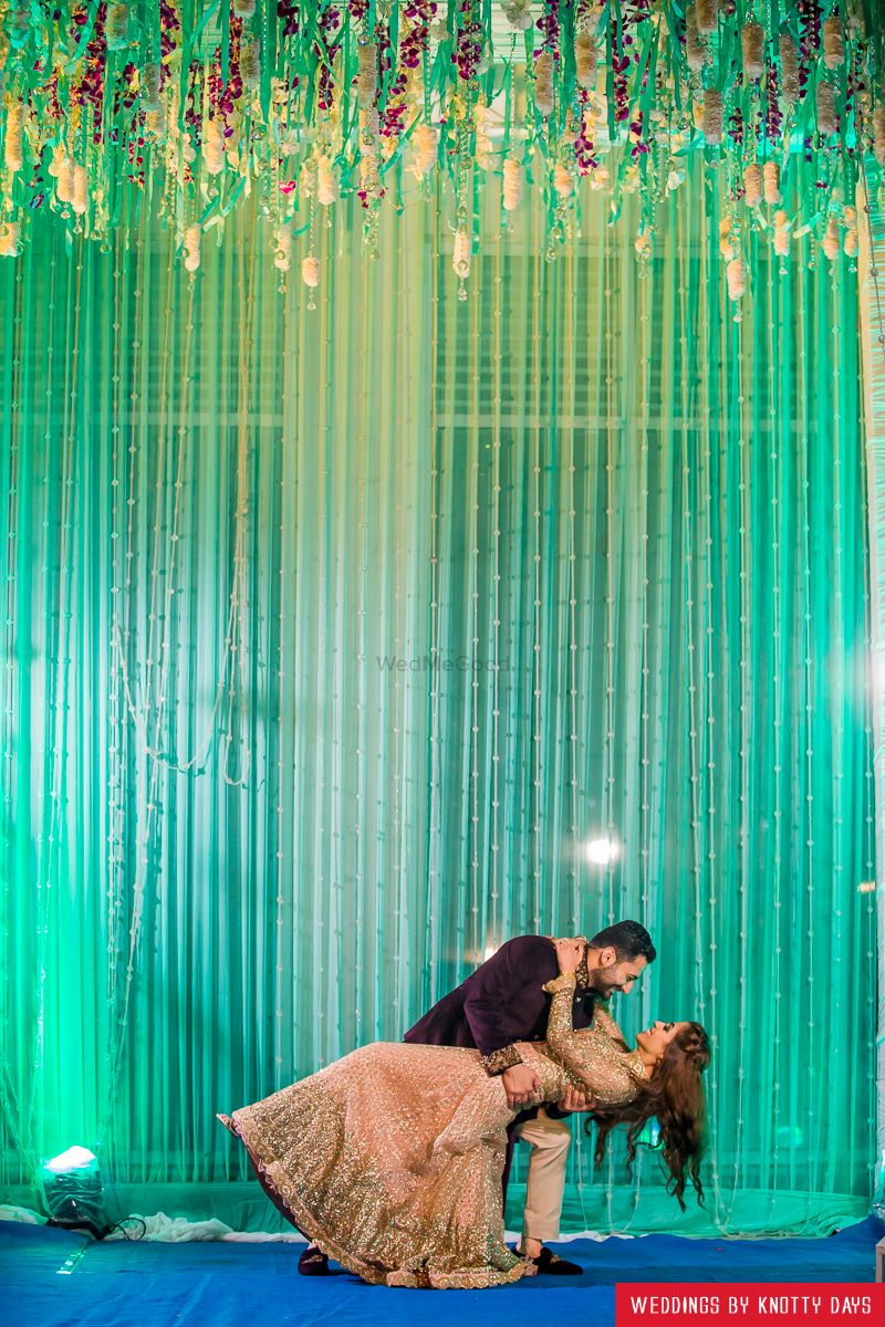 Day wedding stage decoration  Sea green backdrop with hanging florals for a sangeet night