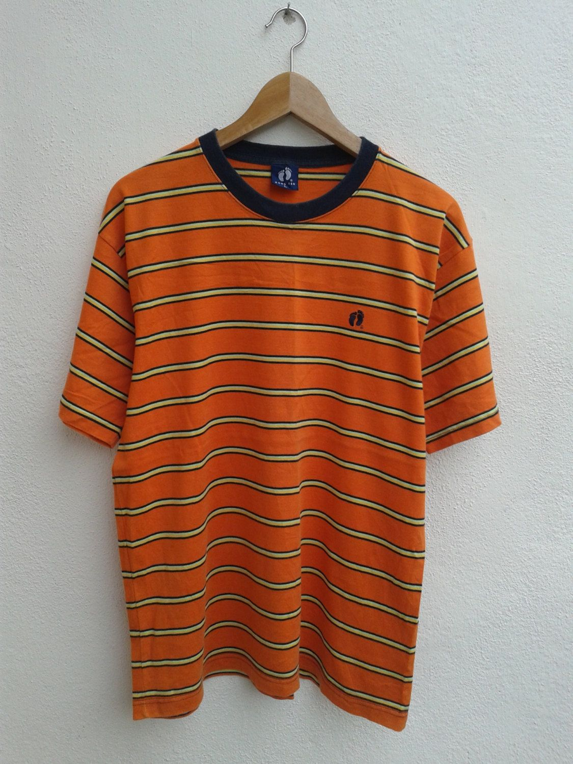 a4d2c2fe 20% YEAR END SALES Vintage 90s hang Ten Surfing Gear Foot Print Embroidered  Orange Stripes T-Shirt - $16.80 USD
