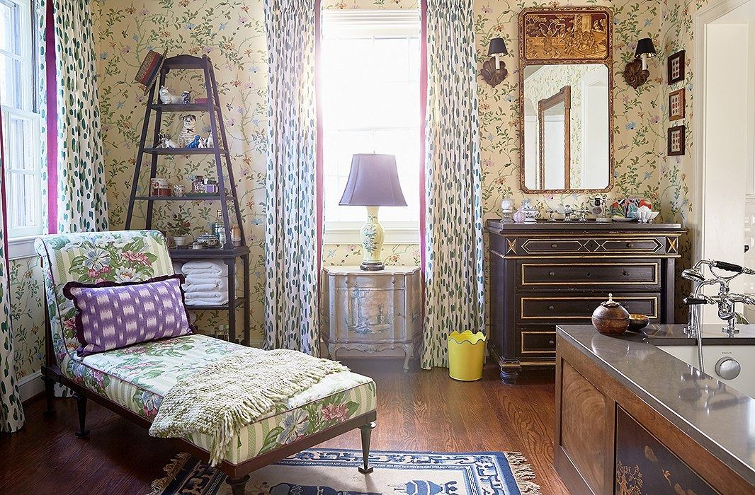 The duo behind the design firm Madcap Cottage echo their home's historical bones by bringing in vintage pieces (an 18th-century chest turned into a sink vanity, a vintage chinoiserie panel incorporated into the side of the tub) into their master bath for a look full of heritage and sophistication.