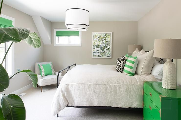 Welcoming White And Green Bedroom Features A Wrought Iron Bed Dressed In Light Gray Bedding Topped With Green Gray Bedroom Walls Bedroom Green Black Iron Beds