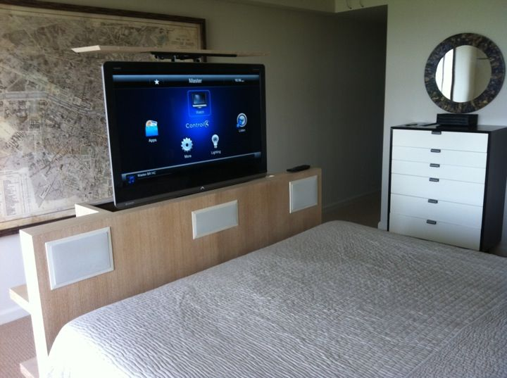 """46"""" tv in custom lift at the foot of a king size bed with"""