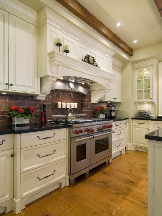 Glazed Cabinets And Brick Backsplash
