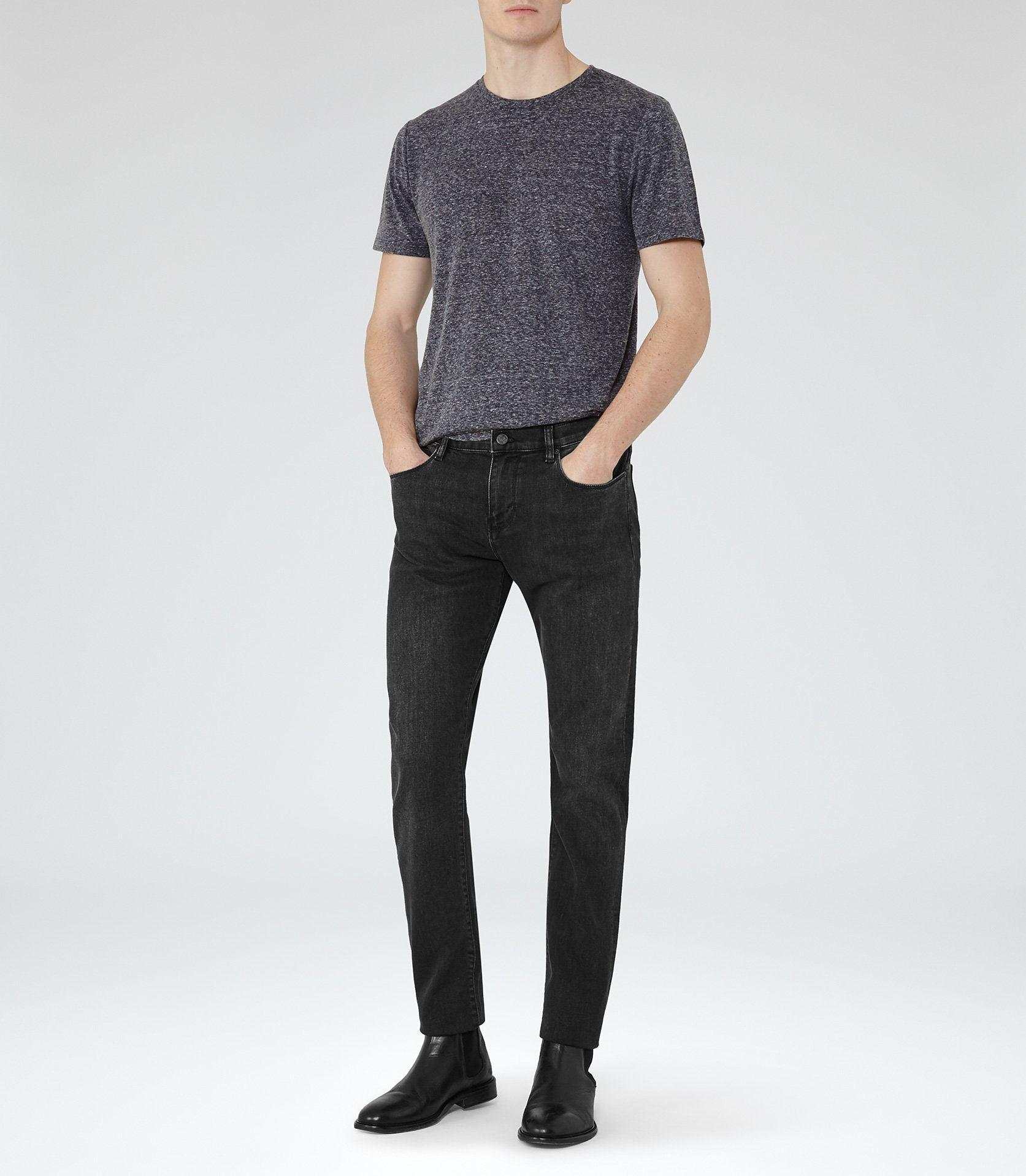 Dark grey t-shirt + Black Grey jeans + chelsea boots