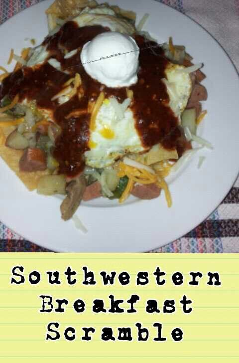 sausage.chicken.bell pepper.mushroom. onion.red potatoes.over chips.topped with red sauce.cheese and over easy eggs... Comfort Dish...