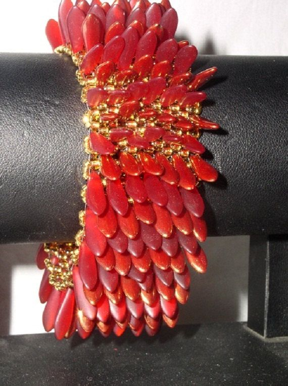 Red and gold Czech glass dagger bead bracelet, and peacock and silver. $85.00, via Etsy.