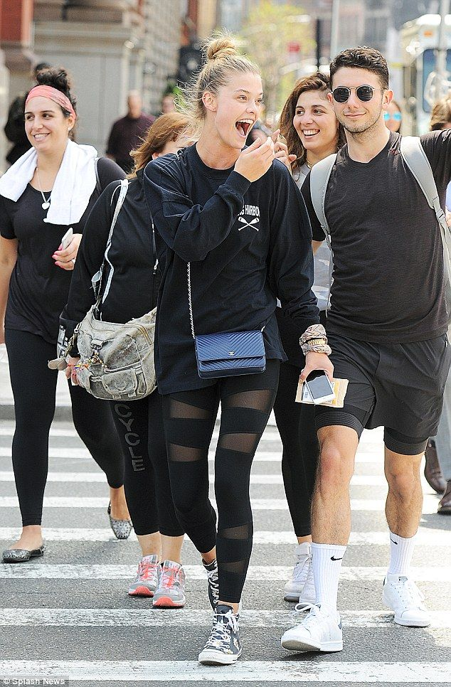 Fashionista: Proving gym wear can also be stylish, the Victoria's Secret model highlighted her lithe legs in a black leggings, which boasted racy mesh inserts