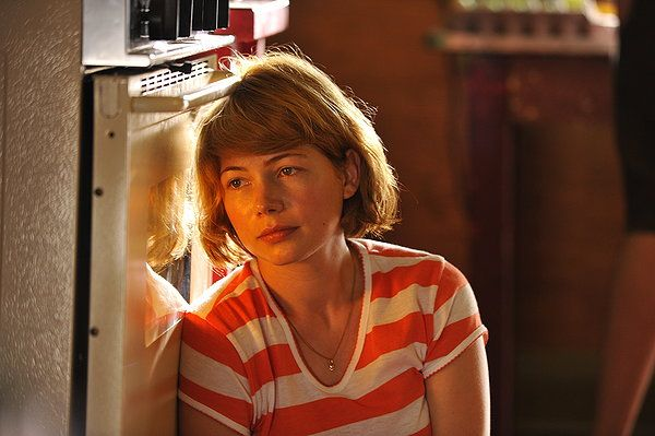 MICHELLE WILLIAMS plays a 28-year-old married woman who falls in love with their new neighbor. Will she give in to the temptation? Sarah Polley's independent film TAKE THIS WALTZ is a heartbreaking drama that will stay with you for a long, long time. [double-click image to read my review]