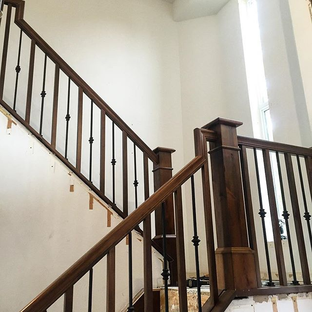 New Stair Railing Going In Loving The Alternating Wood And Metal Balusters We Went With Sidenote Their Sho Wood Staircase Stair Railing Metal Stair Railing