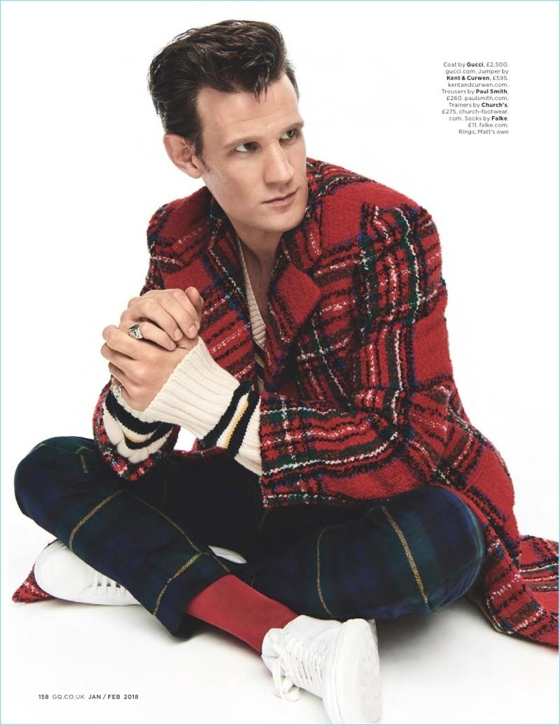 7730cf99405092 Starring in a British GQ photo shoot, Matt Smith wears a Gucci coat with a  Kent & Curwen sweater. Smith also dons Paul Smith trousers and Church's  sneakers.
