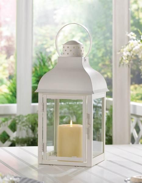 A Pillar Of Style On The Outside With The Pillar Candle Of Your Choice On The Inside This Large Metal Lan White Lanterns White Candle Lanterns Candle Lanterns