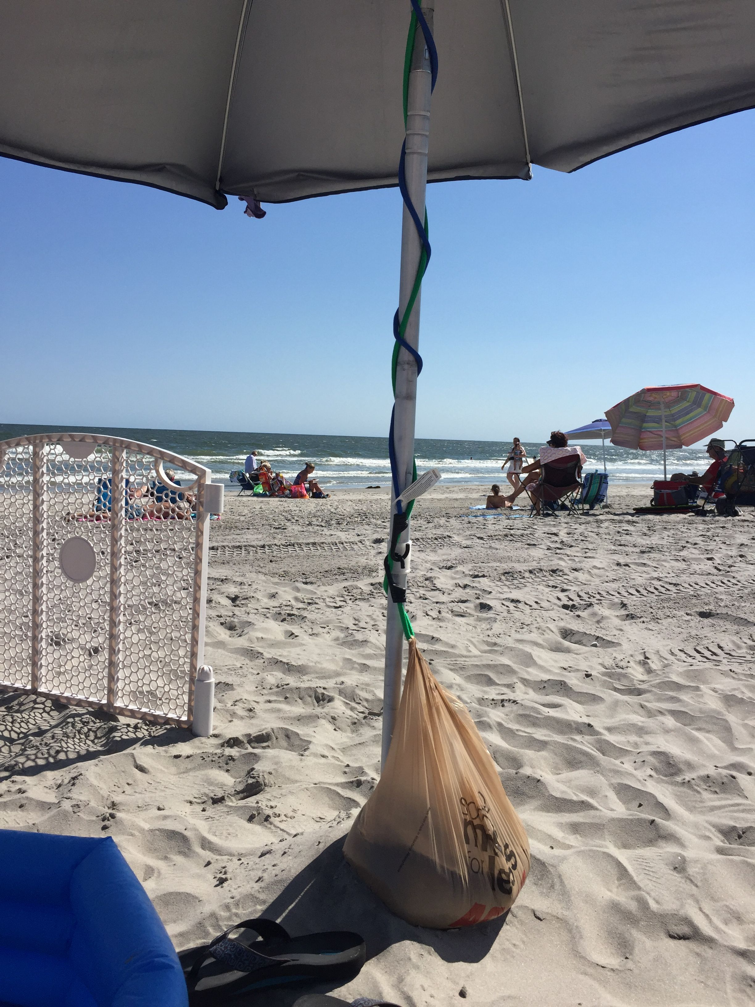 Safety trick to help secure beach umbrellas on a windy day