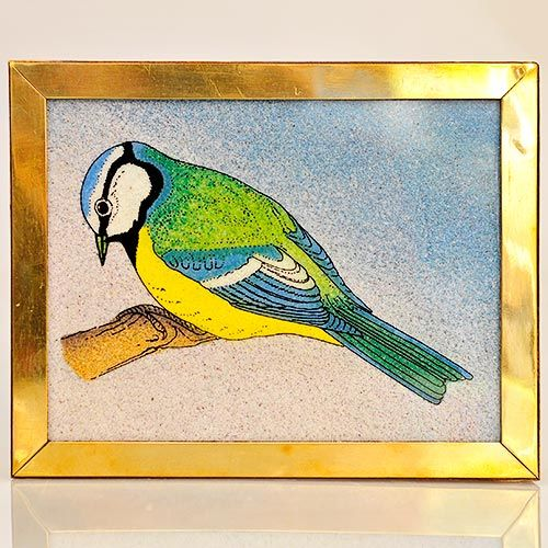 Really lovely Sheesham wood box inlaid with brass and with a beautiful picture of a blue tit on the top. The blue tit is outlined in ink on a glass panel and the different colours are made by the careful use of different crushed gemstones. A key to the gemstones used is included with the box. The glass top is held in place by a brass border. The inside of the case is covered in felt as is the base, for protection.  Length : 134mm Width : 110mm Height : 37mm