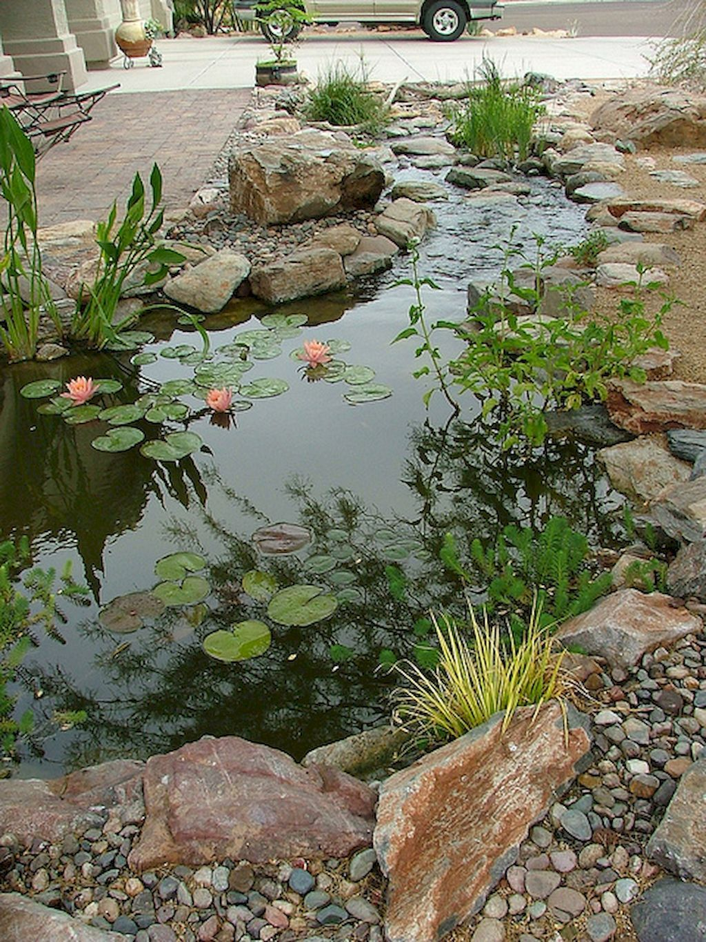 Beautiful backyard ponds and waterfalls garden ideas 56 for Koi pond landscaping ideas