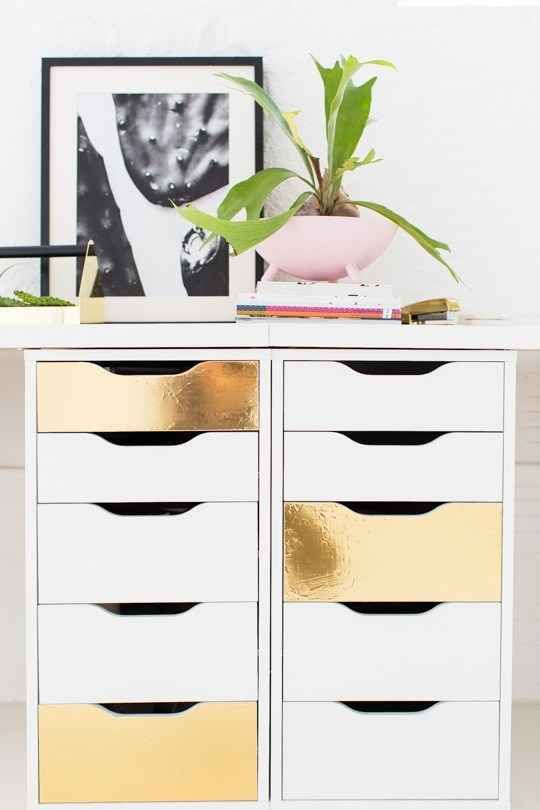 Gild accent drawers with some adhesive and inexpensive gold foil: