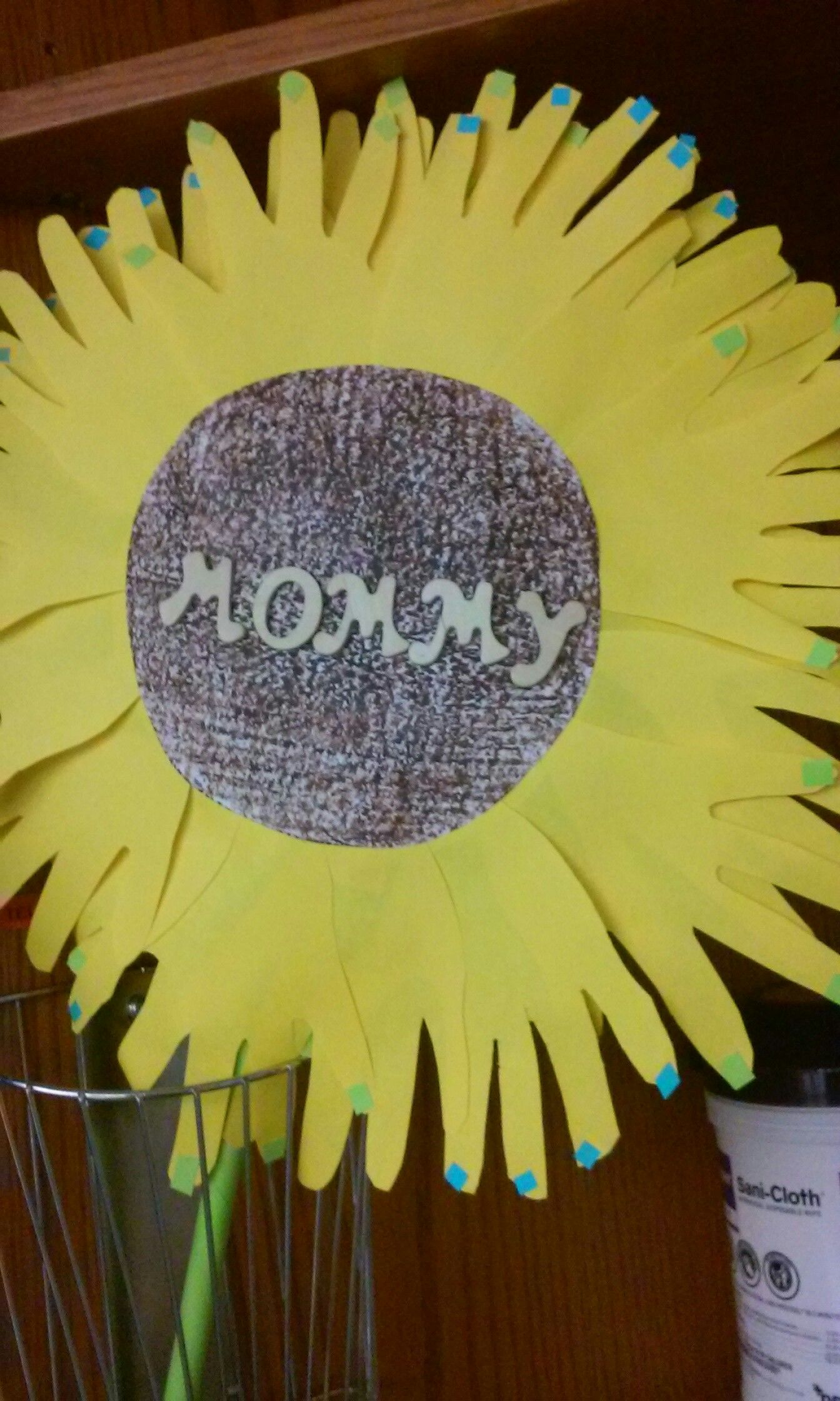 Mothers day child palm of hand sunflower