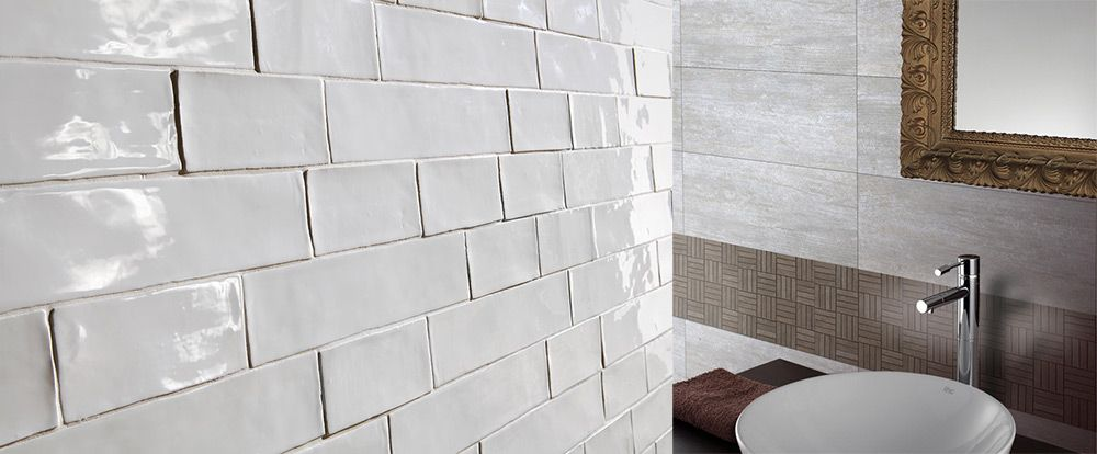 argila white vintage subway tiles paired with brooklyn ash large petrified wood look tiles