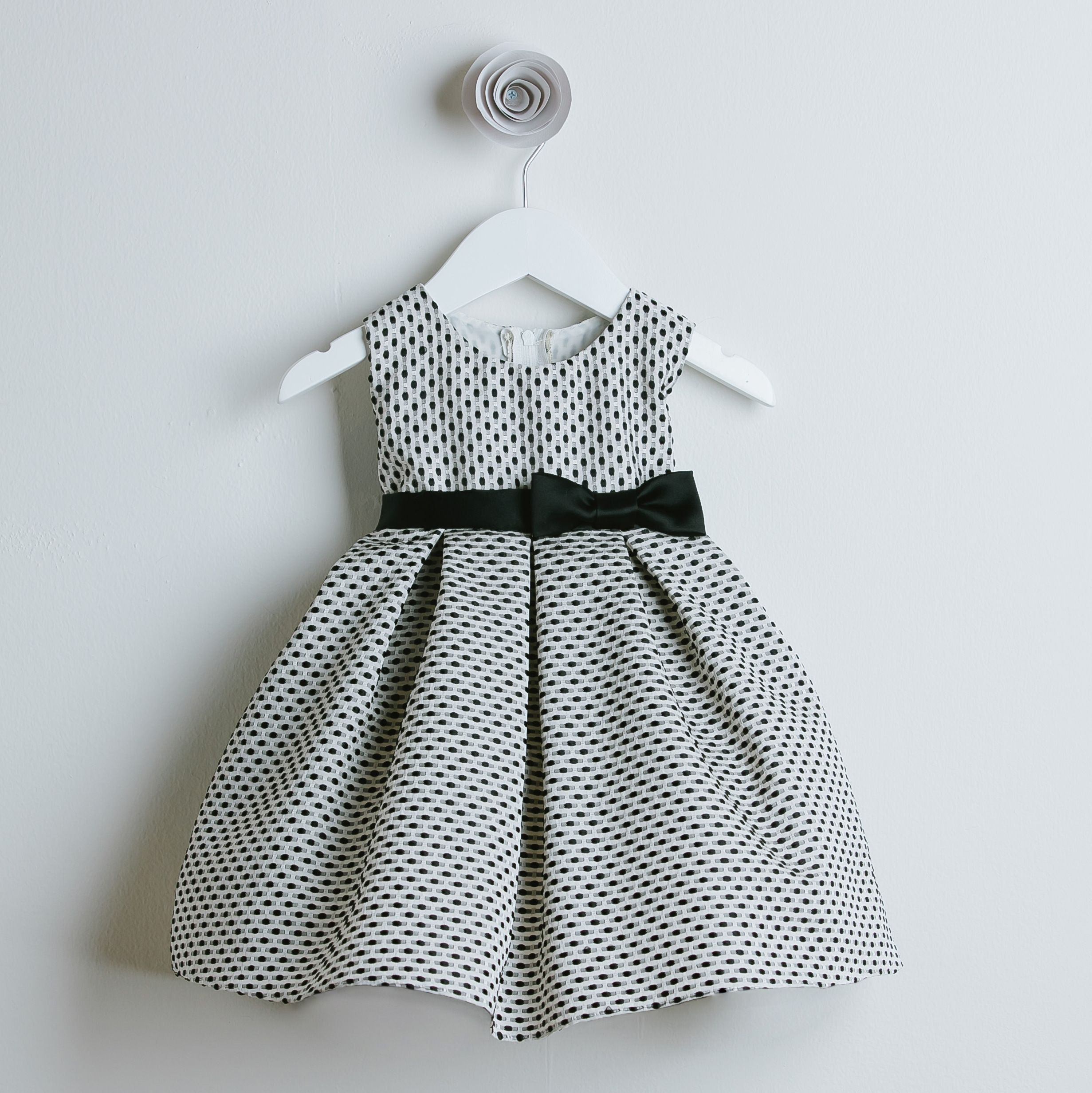 Your little girl will look gorgeous in this black Polka Dots Jacquard dress by Sweet Kids! This is the perfect gown for a special occasion