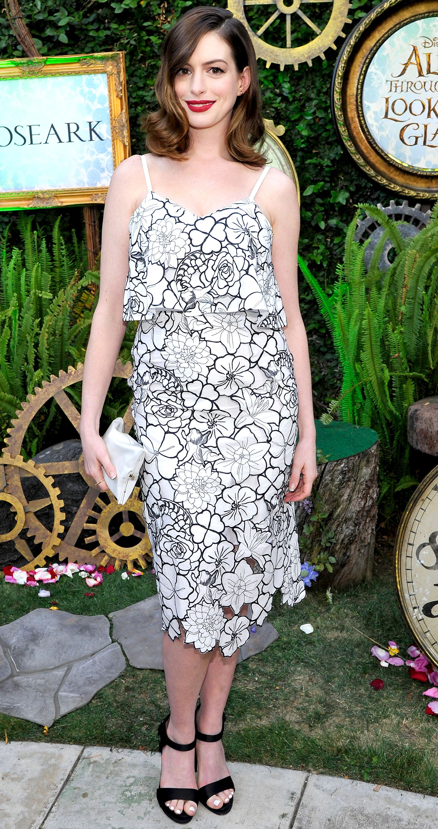 75f94d619d7 Anne Hathaway in a black-and-white floral Disaya dress