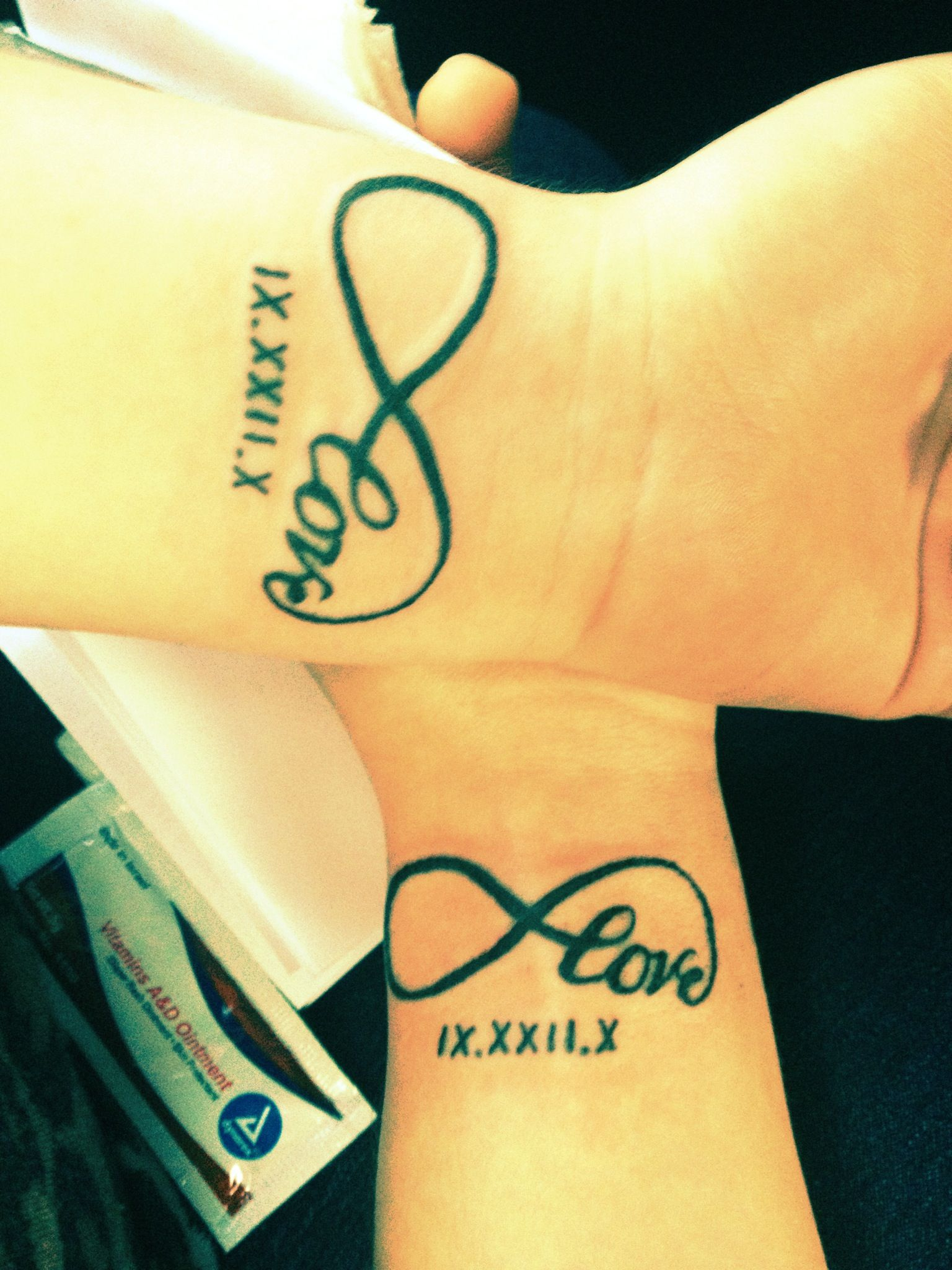 41dee9b8c8383 Couple tattoo, love infinity with the date in Roman numerals on wrist.