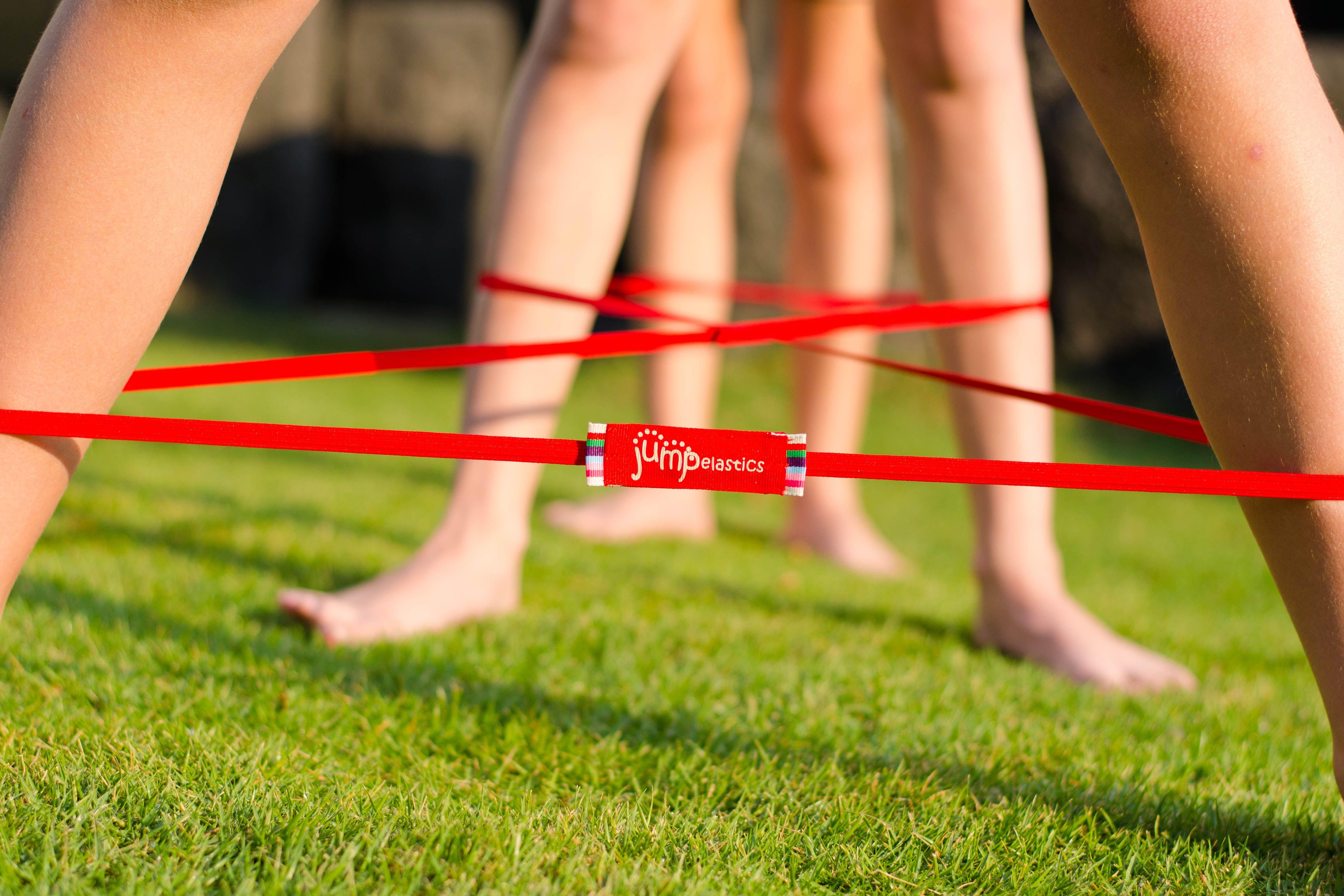 Bare feet green grasssummer fun with jumpelastics