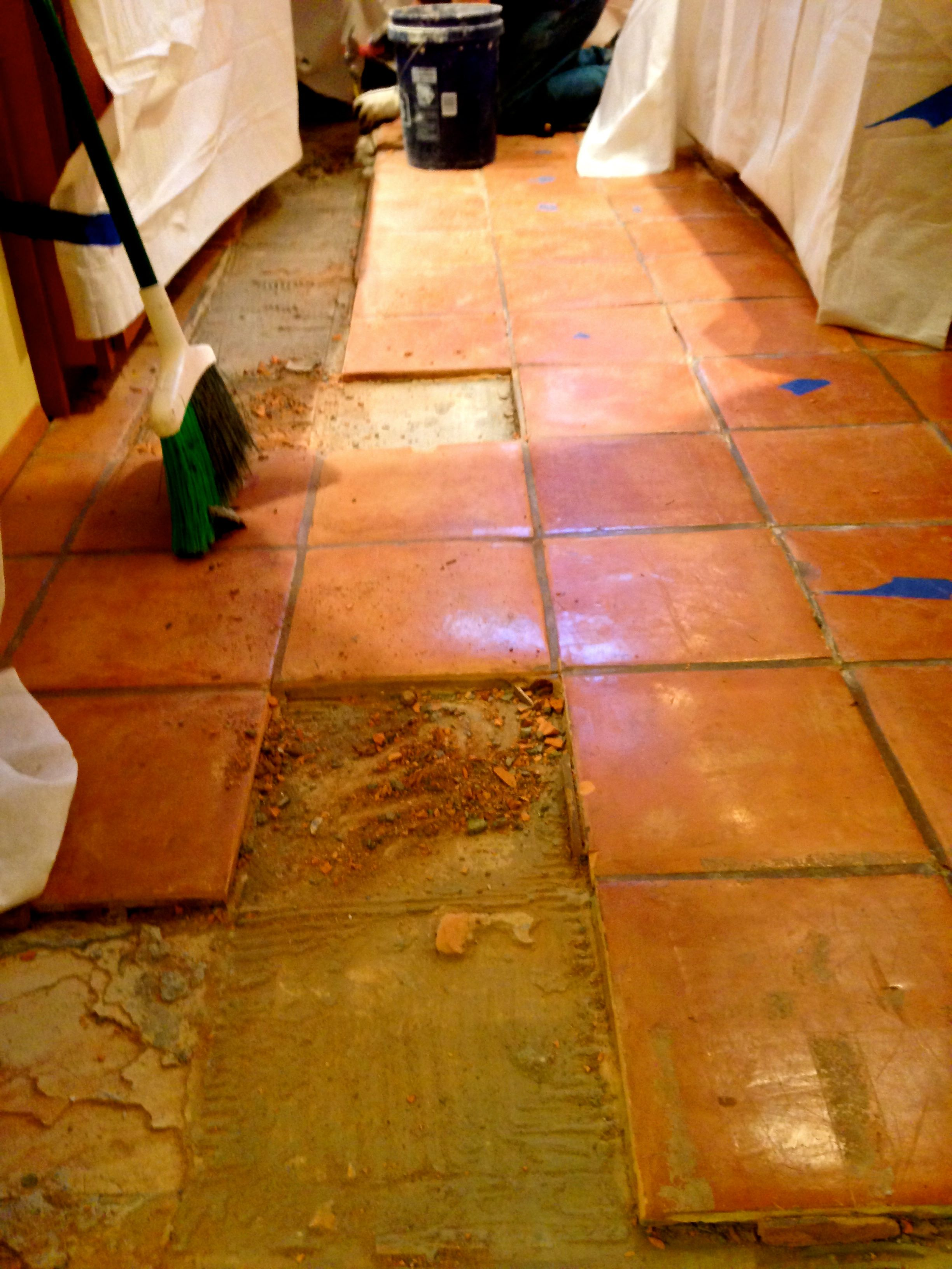 Removal Of Aging And Damaged Saltillo Tile To Refresh The Floors