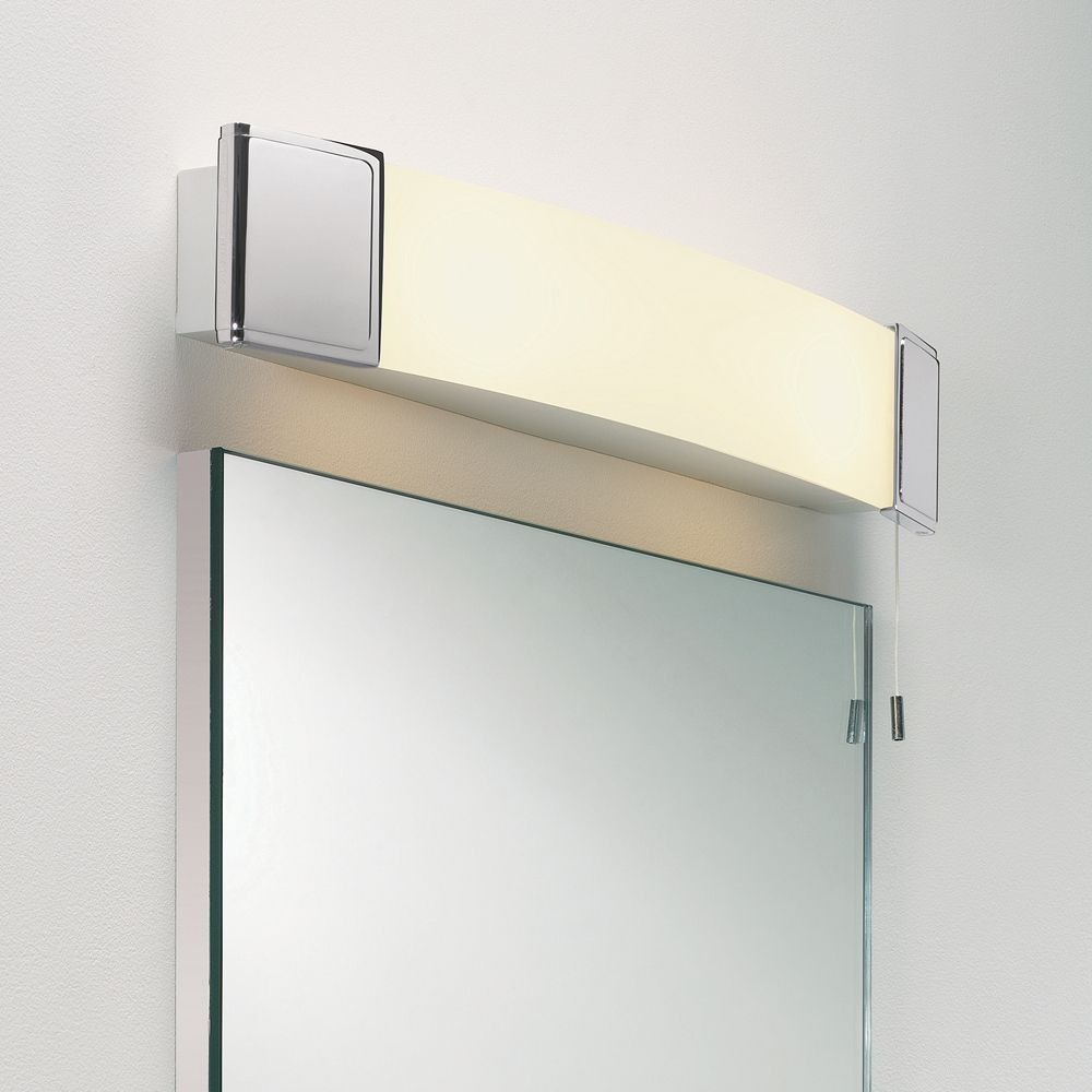 The anja shaver light has a shaver socket discreetly placed and an astro 0512 anja ip44 shaver bathroom wall light in polished chrome aloadofball Images