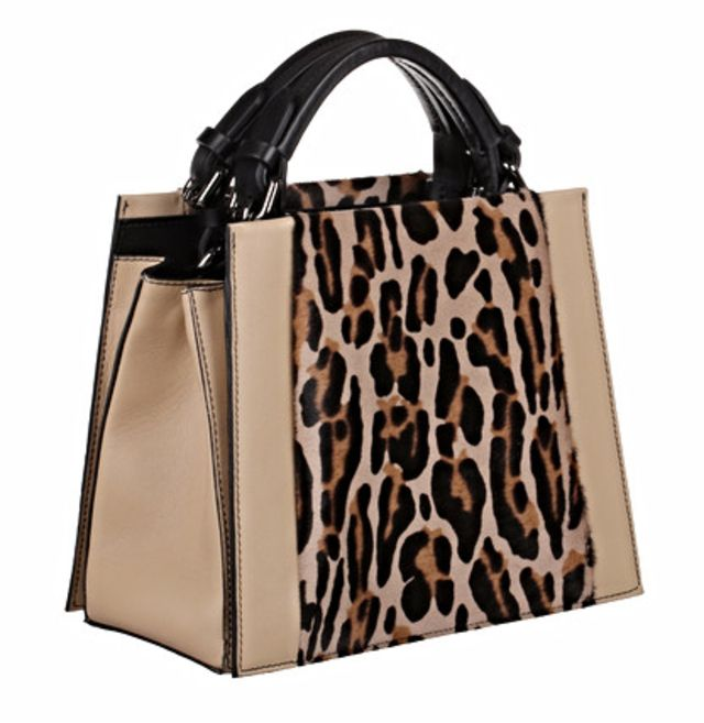 A structured satchel handbag in ivory calf leather with pony hair leopard  panel made from goat skin 7df54094ae342