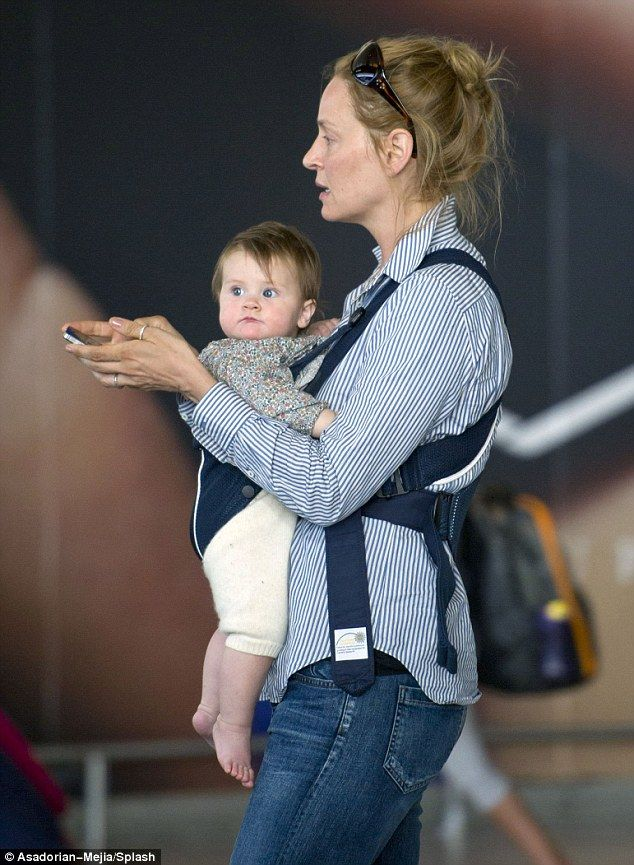 a5aefaef529 Make-up free Uma Thurman returned from her whirlwind Cannes adventures  toting baby daughter Luna at JFK Airport in New York Monday