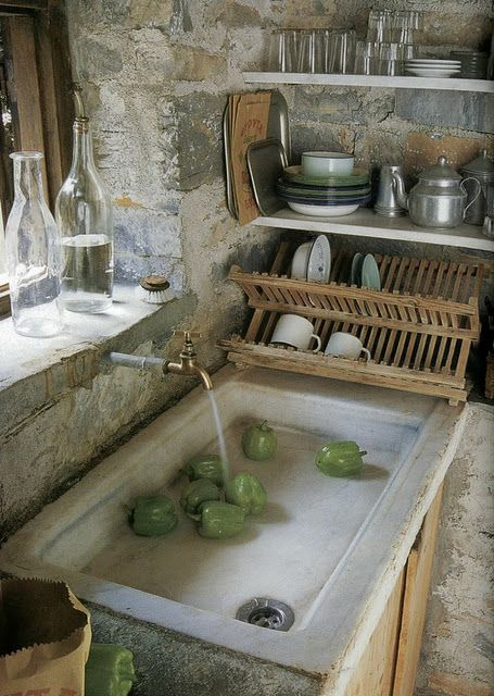 Love the stone walls, deep window sill and fabulous sink ...