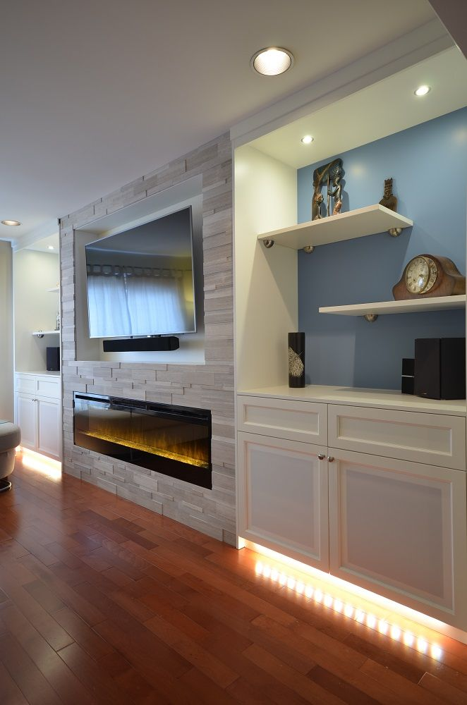 custom cabinetry flanking wall with electric fireplace set into silver fox strips stone wall